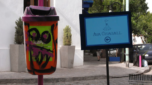 Trash Bin and Ava Chagall Signpost in Palermo Soho in Buenos Aires, Argentina