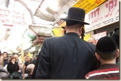 Jewish family shopping before Shabbot at souk