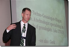 Dan Lawyer explains what it means to be a genealogist-ologist. Church News photo by R. Scott Lloyd.