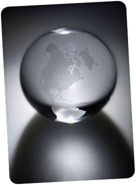 Glass globe on silvery background.