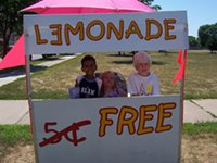 Kids giving away lemonade