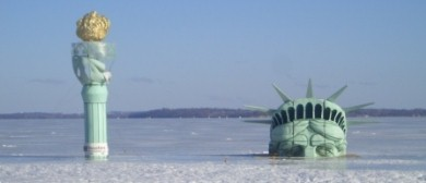 Statue of Liberty replica, seeming frozen in the ice of Lake Mendota