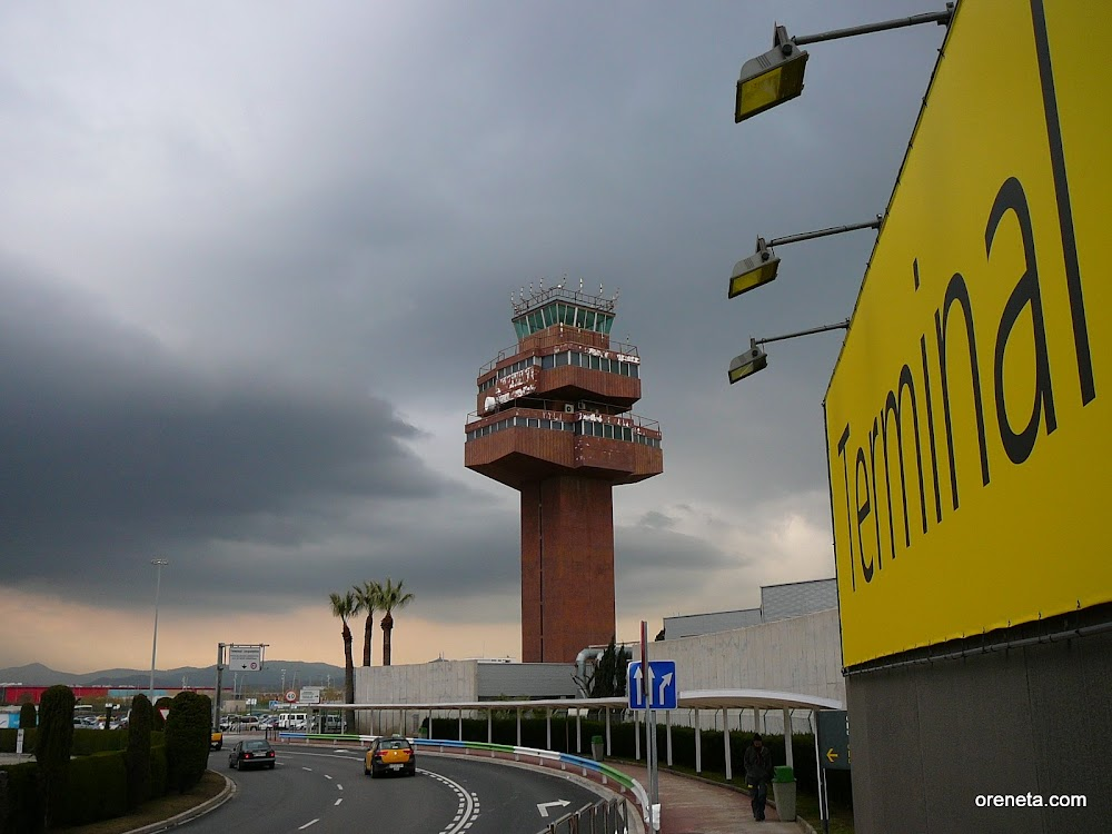 Ricardo Bofill's redundant 1996 Barcelona airport control tower with southern Collserola. I believe the tower was designed redundant--too far away from the runways, the surface coating inhibiting radio traffic.