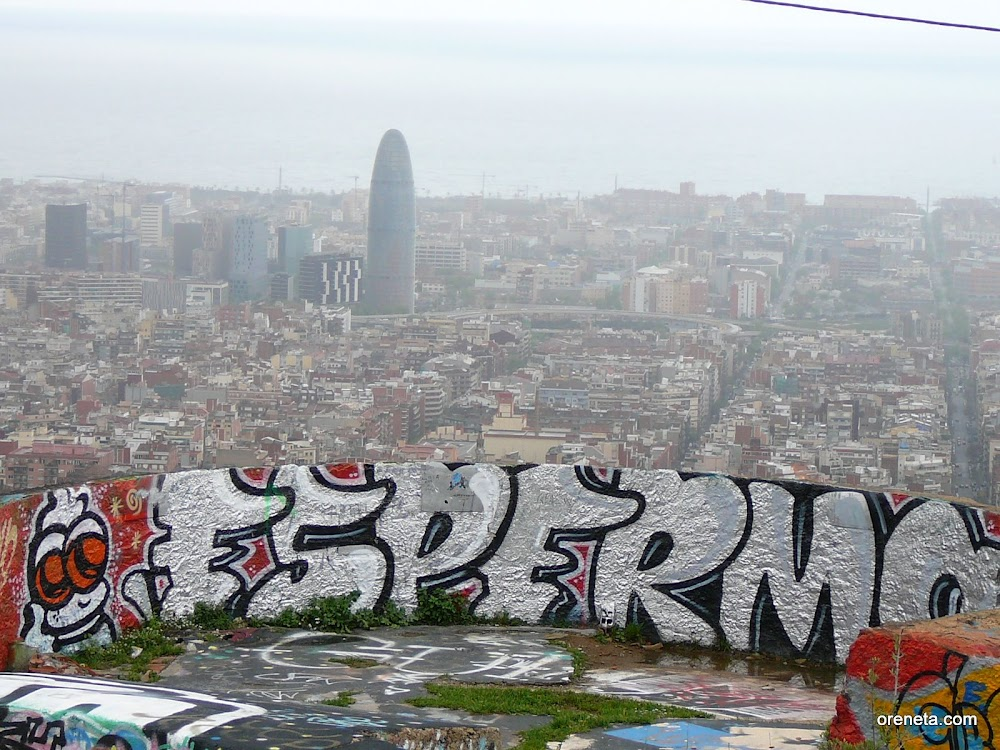 Graffiti on Turó de la Rovira with the Agbar tower in the background.
