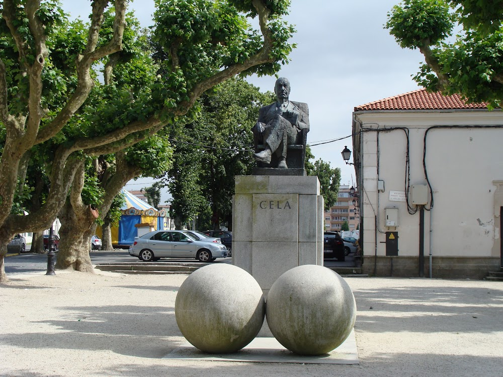 Monument to Iberia's Buster Gonad in <a href='http://maps.google.com/maps?q=padr%C3%B3n&oe=utf-8&client=firefox-a&ie=UTF8&hl=en&hq=&hnear=Padr%C3%B3n,+Corunna,+Galicia,+Spain&ll=42.738944,-8.659973&spn=0.9481,2.469177&t=h&z=9'>Padrón</a>, his native village, <a href='http://commons.wikimedia.org/wiki/File:Estatua_de_Camilo_Jos%C3%A9_Cela_en_Padr%C3%B3n.JPG'>CC</a> by <a href='http://commons.wikimedia.org/wiki/User:Fev'>Fev</a>