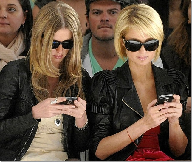 Nikki and Paris Hilton Text at Tracey Reese Fashion Show