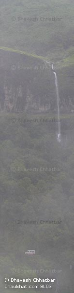 Comparison of a waterfall in Tamhini ghat with a van