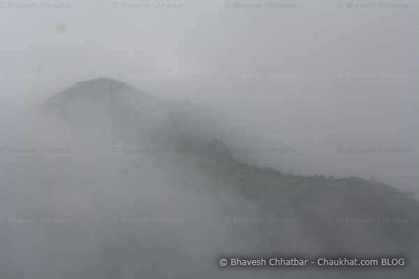 Very dense monsoon clouds covering the forest peaks