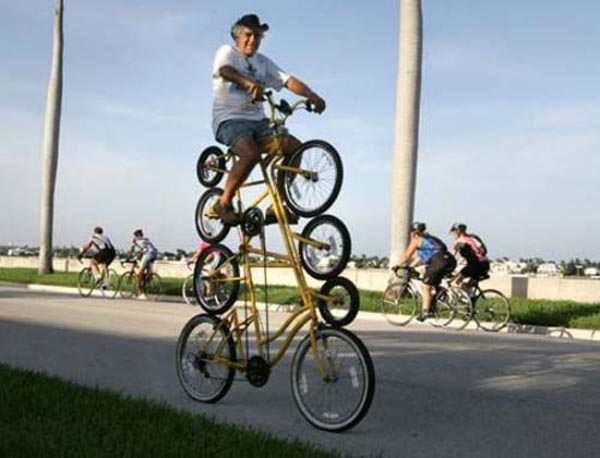 Photos of people doing stupid things - Man on four decker cycle