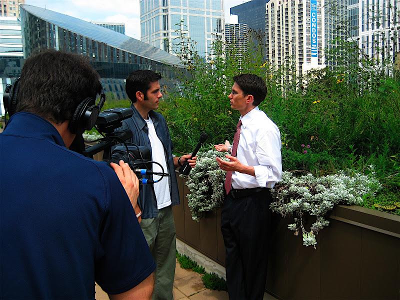 Sadhu Johnston talks with the media