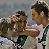 Moenchengladbach's Marko Marin, from left, Moenchengladbach's Karim Matmour and Moenchengladbach's Rob Friend celebrate after scoring during the German first division Bundesliga soccer match between Borussia Moenchengladbach and Werder Bremen in Moenchengladbach, Germany, Saturday, Aug. 30, 2008. (AP Photo/Frank Augstein) **NO MOBILE USE UNTIL 2 HOURS AFTER THE MATCH, WEBSITE USERS ARE OBLIGED TO COMPLY WITH DFL-RESTRICTIONS, SEE INSTRUCTIONS FOR DETAILS**
