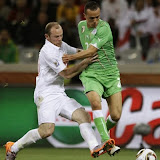 "England's Wayne Rooney, left, competes for the ball with Algeria's Foued Kadir, right, during the World Cup group C soccer match between England and Algeria in Cape Town, South Africa, Friday, June 18, 2010. (AP Photo/Julie Jacobson)?""d???$ث??ث??"
