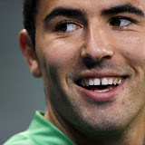 Algeria's captain Antar Yahia smiles during a soccer training session at Green Point stadium in Cape Town, June 17, 2010. REUTERS/Dylan Martinez (SOUTH AFRICA - Tags: SPORT SOCCER WORLD CUP)