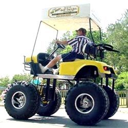 Pro golfing cart 4 by 4 wheel drive in a fire yellow color
