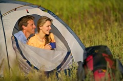 couple_in_tent_shows_backpack