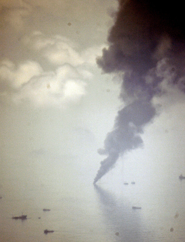 Burning oil sends up a massive plume of black smoke a few miles from the site of the rig explosion in the Gulf of Mexico Thursday, 6 May 2010. JOHN MCCUSKER / THE TIMES-PICAYUNE nola.com
