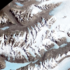 EAST ANTARCTIC MYSTERIES: Even the most snow-covered place on Earth has patches of snow-free ground. In Antarctica, a series of parallel valleys lie between the Ross Sea and the East Antarctic Ice Sheet. Known as the Dry Valleys, they are swept free of snow by nearly relentless katabatic winds -- cold, dry air that rolls downhill toward the sea from the high altitudes of the ice sheet. Jesse Allen, using data provided courtesy of NASA / GSFC / METI / ERSDAC / JAROS, and U.S. / Japan ASTER Science Team