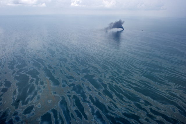 Burning  oil on the surface of the Gulf of Mexico, 17 June 2010. James Duncan  Davidson via flickr