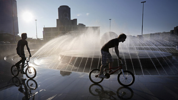 Boys cool off at a fountain in the Ural Mountains city of Yekaterinburg, east of Moscow, on Thursday. Alexander Zemlianichenko / Associated Press