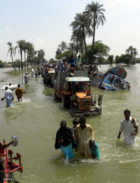 People flee the flooded areas from Basera, near Muzaffargarh, in Punjab Province, Pakistan on 21 August 2010. Pakistan reassured international donors that aid for flood victims would not fall into Taliban hands, as the UN said funds were only trickling in. More than 1,500 people across Pakistan have been killed and hundreds of thousands stranded due to flash floods triggered by the ongoing spell of monsoon rains. EPA / MATIULLAH ACHAKZAI