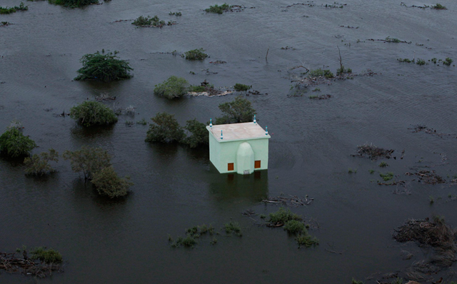 An aerial view shows a flooded mosque in a village in Sujawal, about 150 km (93 mi) from Karachi in Pakistan's Sindh province, August 29, 2010. REUTERS / Akhtar Soomro
