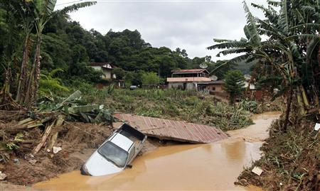 A partially submerged vehicle is seen after a landslide in Teresopolis, Brazil, January 13, 2011. REUTERS / Bruno Domingos