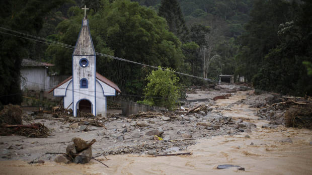 A church is surrounded by debris and floodwaters after a landslide in Teresopolis, Rio de Janeiro state. Felipe Dana / AP