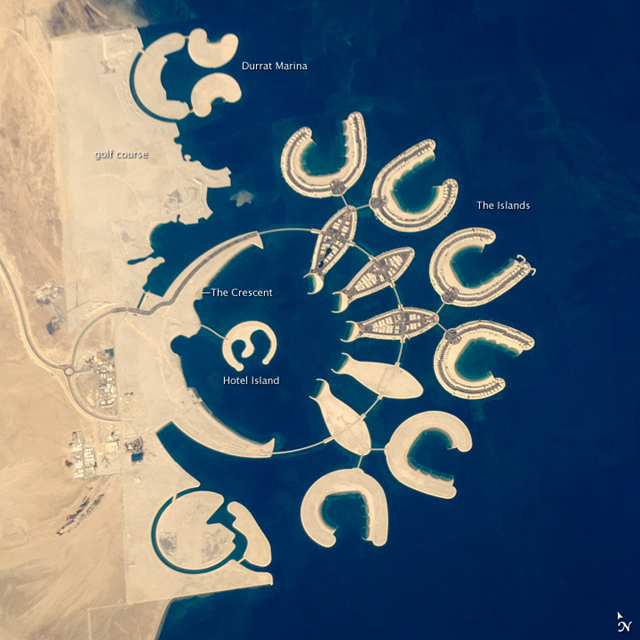 This ISS astronaut photograph, taken 23 January 2011, shows a new complex of 14 artificial islands that has risen out of the sea. Designed for residential living and tourism, and aimed at a cosmopolitan clientele, the Durrat Al Bahrain includes 21 square kilometers (8 square miles) of new surface area for more than 1,000 residences, luxury hotels, and shopping malls. NASA / JSC