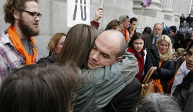 Tim DeChristopher hugs people as he leaves court following a guilty verdict on two federal charges — interfering with an onshore oil and gas leasing act and making a false representation to the federal government — in Salt Lake City on Thursday, March 3, 2011. Ravell Call, Deseret News