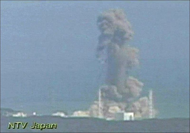 In this image taken from Japan's NTV/NNN Japan television footage, smoke ascends from the Fukushima Dai-ichi nuclear plant's Unit 3 in Okumamachi, Fukushima Prefecture, northern Japan, Monday, 14 March 2011. The second hydrogen explosion in three days rocked Japan's stricken nuclear plant Monday, sending a massive column of smoke into the air and wounding 11 workers. NTV