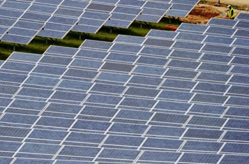 A technician inspects newly installed solar panels. AFP / File, Boris Horvat