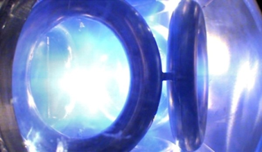 Plasma shines within EMC2 Fusion's WB-7 device, the predecessor to the WB-8 inertial electrostatic confinement vessel currently being used for fusion experiments. EMC2 Fusion