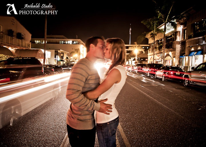 kissing in city street at night