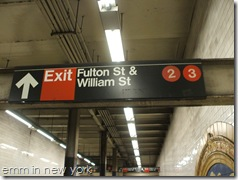 Signs at Fulton Street subway