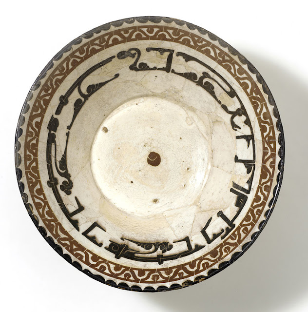 "The inscription on this bowl reads, ""Generosity is a disposition of the dwellers of Paradise."" The letters are horizontally elongated to fit the available space. Iran, Nishapur. 10th century. Kufic script. Courtesy of the Nasser D Khalili Collection of Islamic Art."
