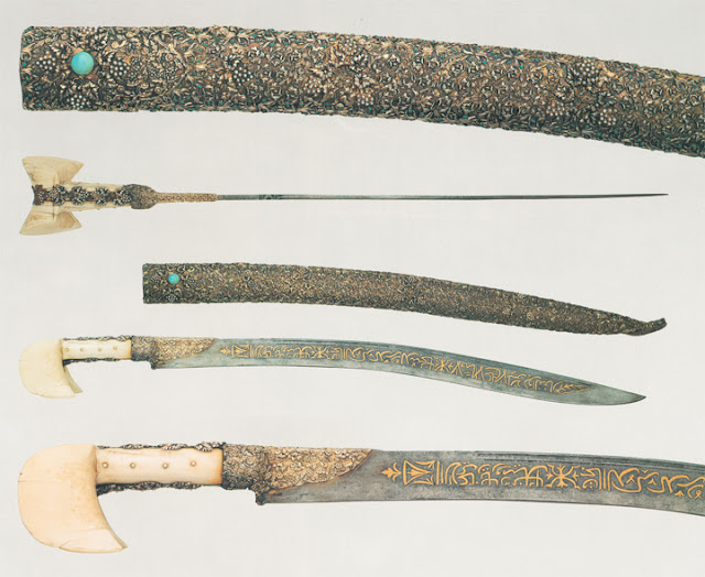 This blade bears topical inscriptions in praise of 'Ali and his sword Dhu'l-Faqar. The scabbard is tipped with a dragon's head with ruby eyes.