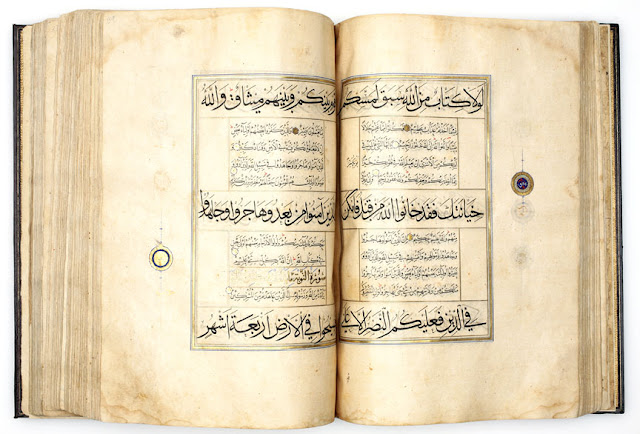 The illumination of the opening spread is in the Timurid Herati style of the late 15th century. The top and bottom darker headings are in the muhaqqaq script, and the middle darker heading is in the thuluth script.erat or Tabriz, Iran. 1525-1550 A.D. Muhaqqaq, Thuluth and Naskh scripts. 36 x 24.5 cm. Courtesy of the Nasser D Khalili Collection of Islamic Art.
