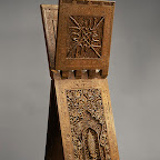 This impressive Quran stand, or rahla, one the most accomplished works in wood to survive from Iran, bears the signature of its carver, who was probably from Isfahan in central Iran. The splendid carved decoration, which includes the motif of a flowered bush within a niche surrounded by calligraphic blessings upon the Prophet and the Twelve Imams, reveals a Shici association. Other inscriptions include the date as well as the name of the patron who ordered this stand for a madrasa (theological school), but they do not give the name of the school or the city where it was located.