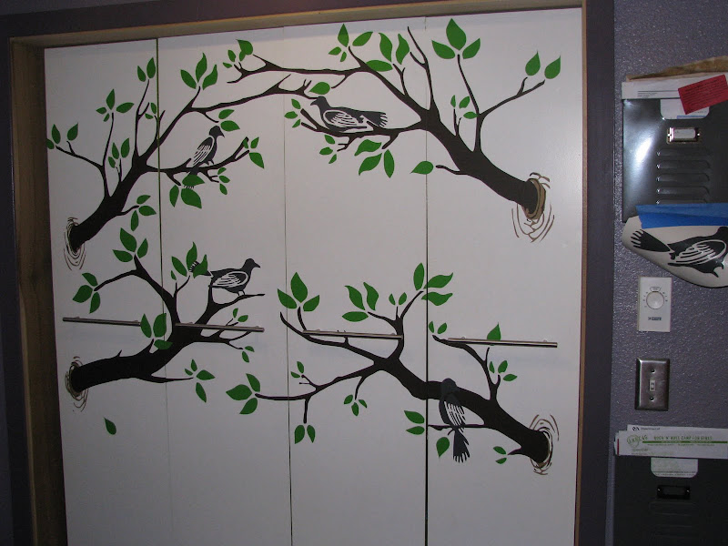 The fully remodeled closet with tree and bird graphics