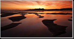 Neil_Maughan,_Dawn_over_Dunstanburgh