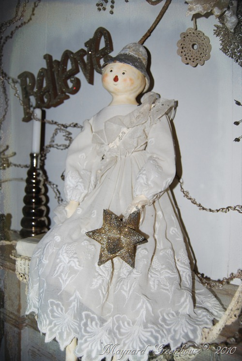 evi doll on mantel