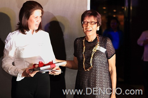 Author Sonia Ner Gives A Copy of the Book to Max's Carolyn Salud