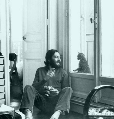 Julio Cortazar amused by a kitty.jpg