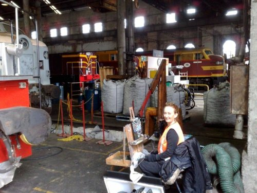 artist Jane Bennett painting in Eveleigh Railway Workshops