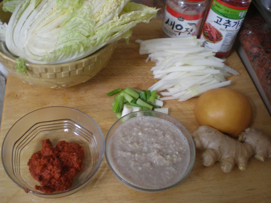 The ingredients with the two homemade sauce-pastes in the bottom left