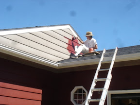 image of me painting the house