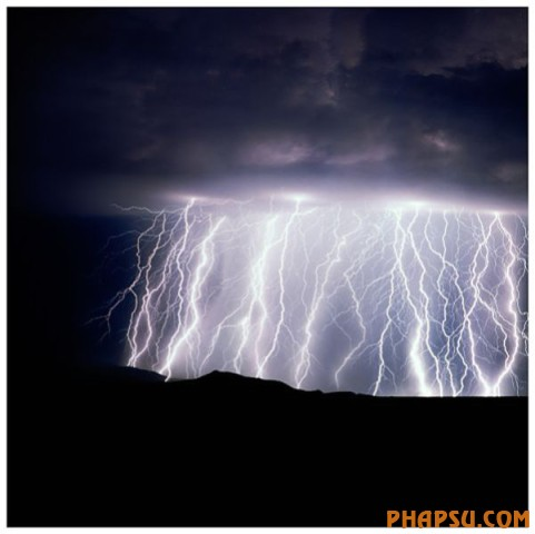 Million Volt Curtain Arizona The Rincon mountains, east of Tucson, are notorious for its fierce storms.  This particular evening storm had the greatest amount of lightning I have ever seen.  1997