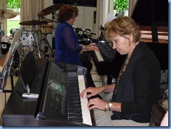 Joy Eade in piano heaven on the grand piano with Carole Littlejohn accompanying on the Clavinova CVP-303