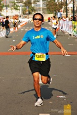 One of the runners finally reaching the finsih line