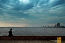 A man enjoying the refreshing air of Manila Bay